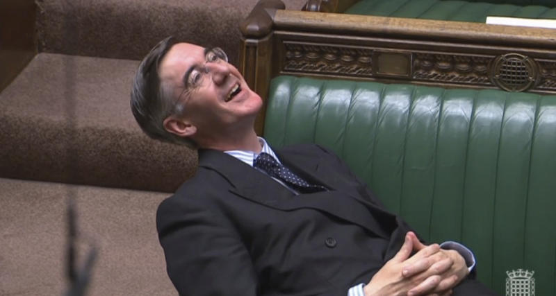 "Britain's Leader of the House of Commons Jacob Rees-Mogg reclines on his seat in the House of Commons, London, Tuesday Sept. 3, 2019. With Britain's prime minister Boris Johnson weakened by a major defeat in Parliament, defiant lawmakers were moving Wednesday to bar him from pursuing a ""no-deal"" departure from the European Union.(Parliament TV via AP)"