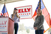 Sen. Kelly Loeffler, R-Ga., and Republican congressional candidate Marjorie Taylor Greene speak during a news conference on Thursday, Oct. 15, 2020, in Dallas, Ga. (AP Photo/Brynn Anderson)