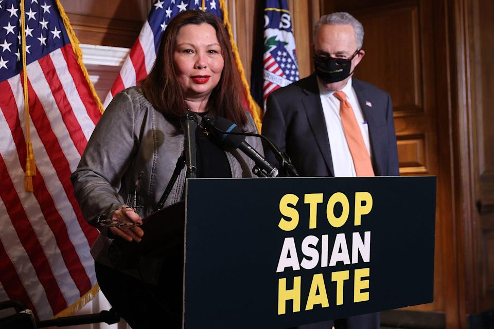 Sen. Tammy Duckworth, D-Ill., and Senate Majority Leader Charles Schumer, D-N.Y., promote the passage of the COVID-19 Hate Crimes Act at the U.S. Capitol on April 22.