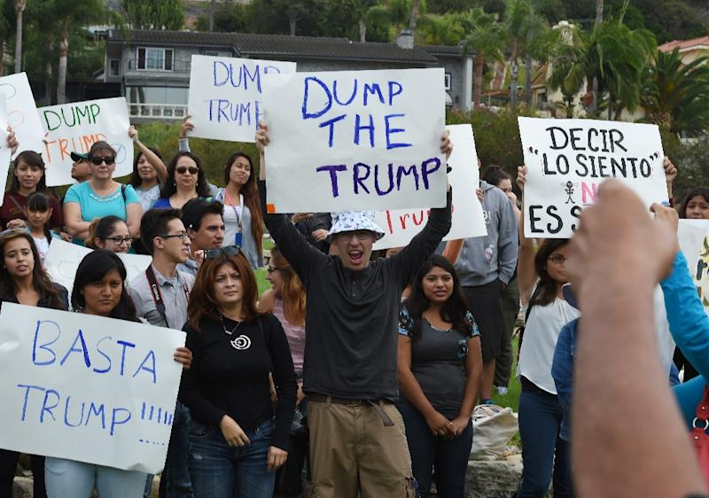 People march during a protest rally denouncing alleged racist remarks by Republican presidential candidate Donald Trump, at the Trump National Golf Club in Palos Verdes, California on October 17, 2015 (AFP Photo/Mark Ralston)