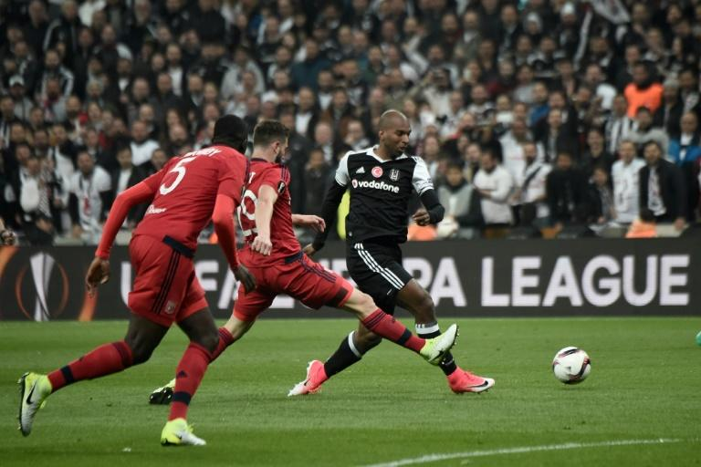 Besiktas' Ryan Babel (R) vies with Lyon's Lucas Tousart (C) and Mouctar Diakhaby (L) during the UEFA Europa League second leg quarter final football match April 20, 2017