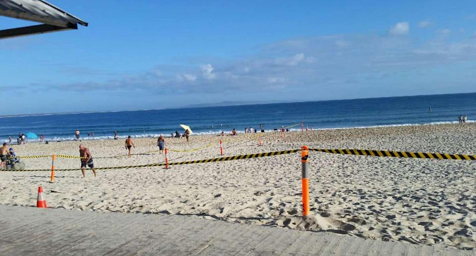 Main Beach, Noosa, is seen cordoned off for clean up after Schoolies 2020.