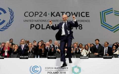 Michal Kurtyka, who led climate talks in Katowice, Poland, shows his relief as an agreement is reached after marathon negotiations - Credit: Kacper Pempel/Reuters
