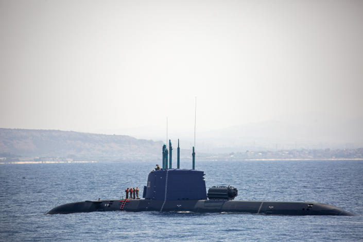 An Israeli Navy submarine is seen near Israel's offshore Leviathan gas field in the Mediterranean Sea, Wednesday, Sept. 1, 2021. In an interview with the Associated Press, Israel's just-retired navy chief Vice Adm. Eli Sharvit, described Iranian activities on the high seas as a top Israeli concern and said the navy is able to strike wherever necessary to protect the country's economic and security interests. (AP Photo/Ariel Schalit)