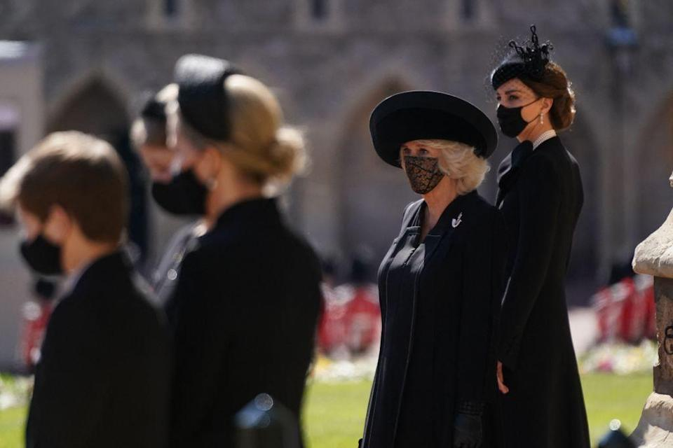 <p>The Duchess of Cornwall and Duchess Kate stand outside St George's chapel before the ceremonial funeral procession.</p>