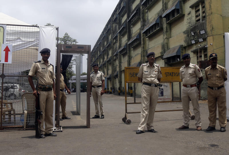 FILE- In this Tuesday, May 21, 2019 file photo, security officials keep vigil outside a vote counting center in Mumbai, India. India's Election Commission has rejected opposition fears of possible tampering of electronic voting machines ahead of Thursday's vote-counting to determine the outcome of the country's mammoth national elections. Authorities on Wednesday tightened security at counting centers where the electronic voting machines have been kept in strong rooms across the country. (AP Photo/Rajanish Kakade, File)