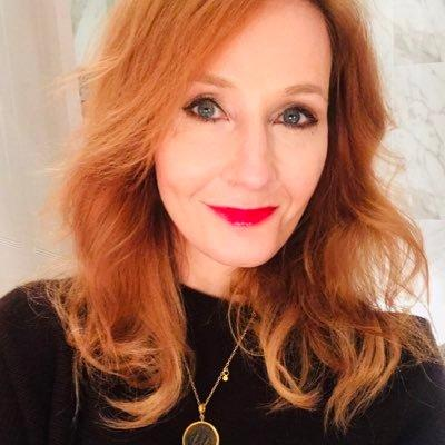J.K. Rowling smiling into the camera