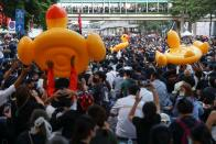 Demonstrators move inflatable rubber ducks during a rally in Bangkok
