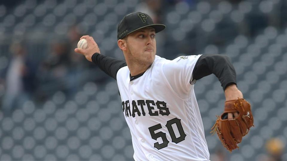 Jameson Taillon delivers pitch to home in white Pirates jersey