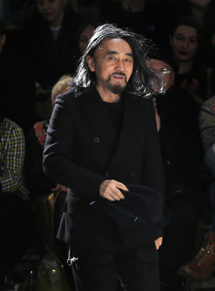 Japanese fashion designer Yohji Yamamoto accepts applause after his Fall/Winter 2013-2014 ready to wear collection, presented in Paris, Friday, March 1, 2013. (AP Photo/Christophe Ena)