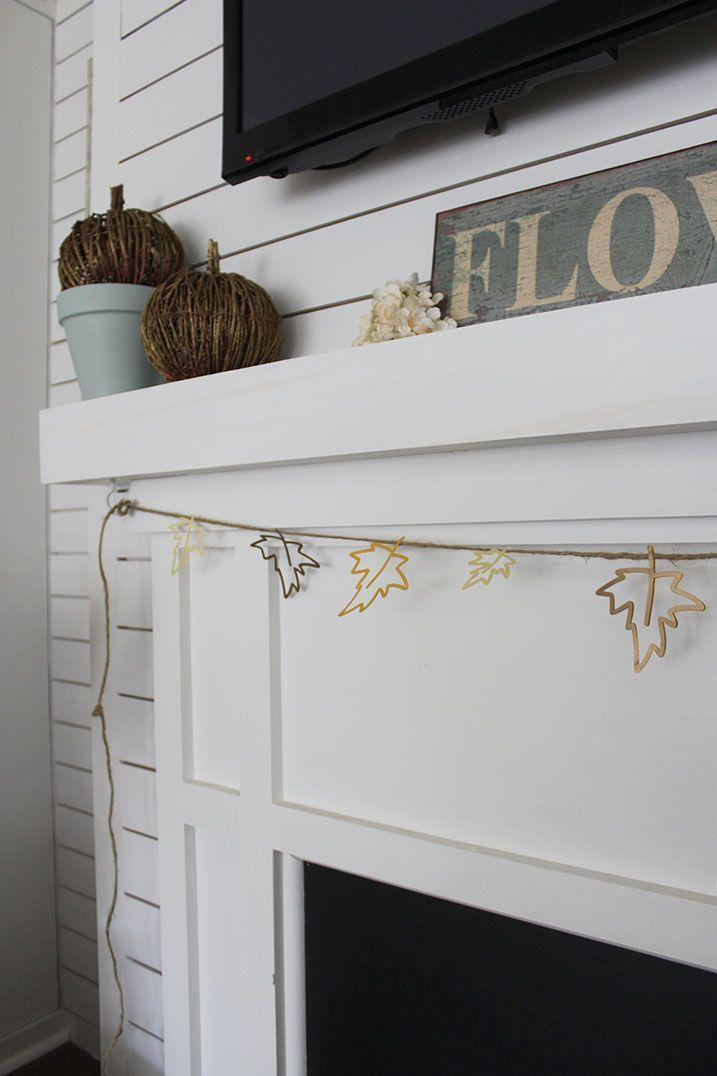 """<p>Using a Cricut Maker, you can craft this subtle-yet-cool cut-out leaf banner to punctuate your fireplace.</p><p><strong>Get the tutorial at <a href=""""https://thehoneycombhome.com/fall-banner-diy/"""" rel=""""nofollow noopener"""" target=""""_blank"""" data-ylk=""""slk:The Honeycomb Home"""" class=""""link rapid-noclick-resp"""">The Honeycomb Home</a>.</strong></p><p><a class=""""link rapid-noclick-resp"""" href=""""https://go.redirectingat.com?id=74968X1596630&url=https%3A%2F%2Fwww.walmart.com%2Fip%2FCricut-Maker-Machine-Champagne%2F886549154&sref=https%3A%2F%2Fwww.thepioneerwoman.com%2Fhome-lifestyle%2Fcrafts-diy%2Fg36891743%2Ffall-mantel-decorations%2F"""" rel=""""nofollow noopener"""" target=""""_blank"""" data-ylk=""""slk:SHOP CRICUT MACHINES"""">SHOP CRICUT MACHINES</a></p>"""