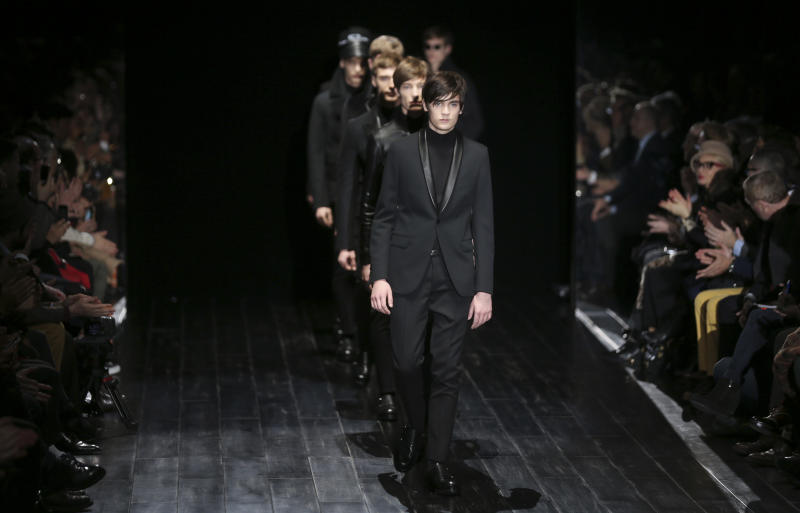Alain Fabien Delon, son of French actor Alain Delon, leads models on the catwalk during the Gucci men's Fall-Winter 2014 collection, part of the Milan Fashion Week, unveiled in Milan, Italy, Monday, Jan.13, 2014. (AP Photo/Luca Bruno)