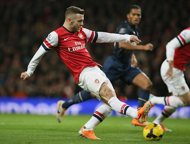 Arsenal's Jack Wilshere takes a shot at goal during their English Premier League soccer match between Arsenal and Manchester United at the Emirates stadium in London, Wednesday, Feb. 12, 2014. (AP Photo/Alastair Grant)
