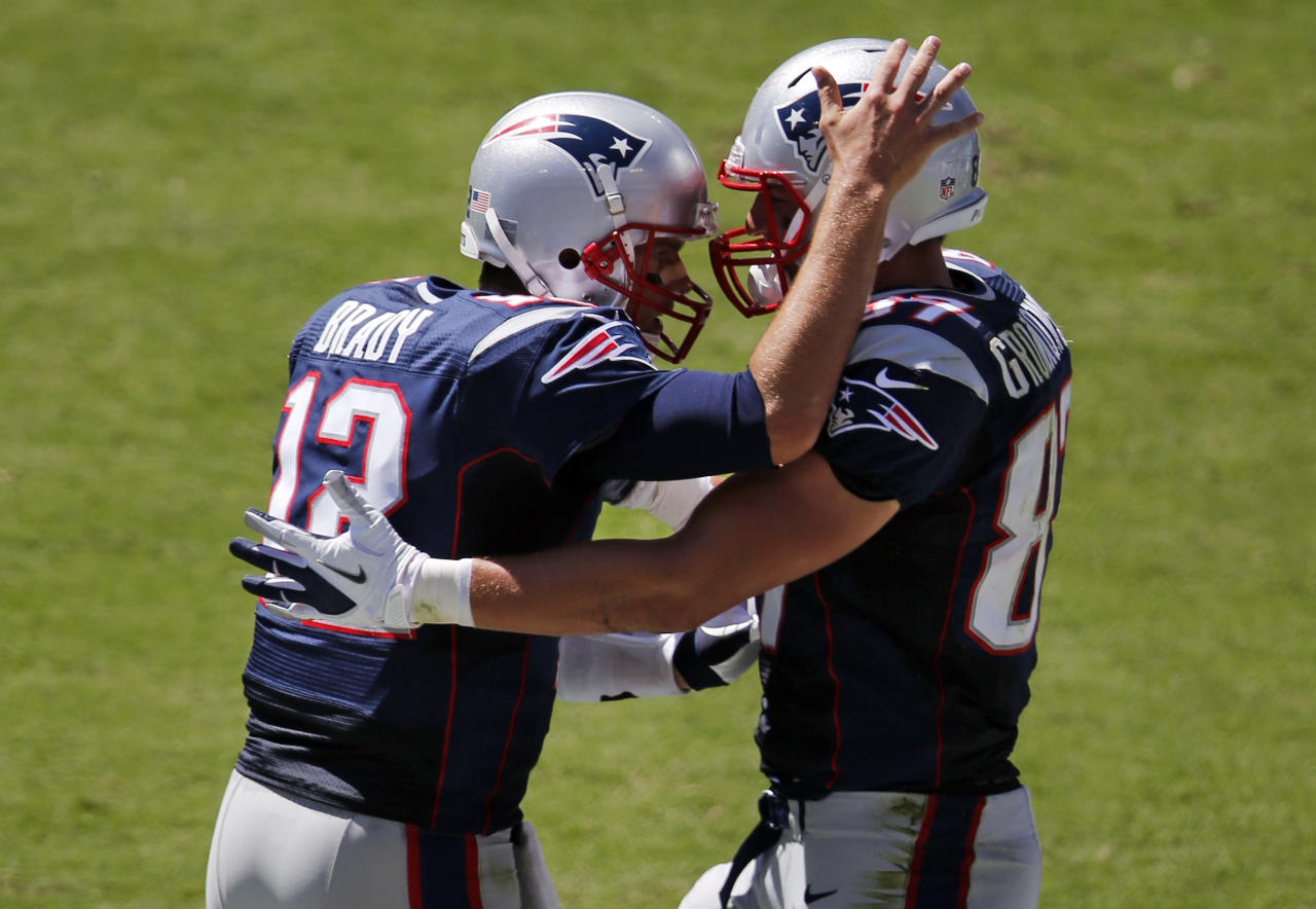 New England Patriots quarterback Tom Brady (12) celebrates with tight end Rob Gronkowski (87) after throwing a two-yard touchdown pass to Gronkowski against the Tennessee Titans in the second quarter of an NFL football game on Sunday, Sept. 9, 2012, in Nashville, Tenn. (AP Photo/Joe Howell)