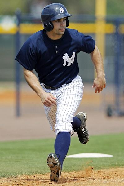 In this Wednesday, March 7, 2012, photo, Scranton/Wilkes-Barre Yankees infielder Kevin Russo practices base-running drills at the Yankees' minor league training complex in Tampa, Fla. The Scranton/Wilkes-Barre Yankees will play all 144 games of their Triple-A season on the road this year, forced out of PNC Field because of a $40 million stadium renovation. (AP Photo/Kathy Willens)