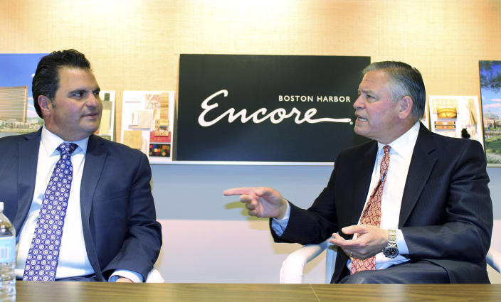 In this June 7, 2019 photo, Encore Boston Harbor casino president Robert DeSalvo, right, speaks to Everett Mayor Carlo DeMaria in the company's administrative office in Medford, Mass. The casino is scheduled to open in nearby Everett on Sunday, June 23. (AP Photo/Philip Marcelo)