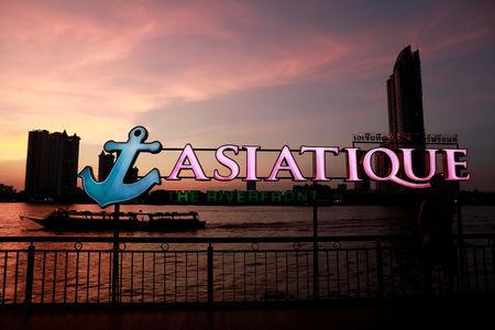 A tourist boat passes in the river near Asiatique night market, in Bangkok, Thailand April 23, 2019. REUTERS/Soe Zeya Tun