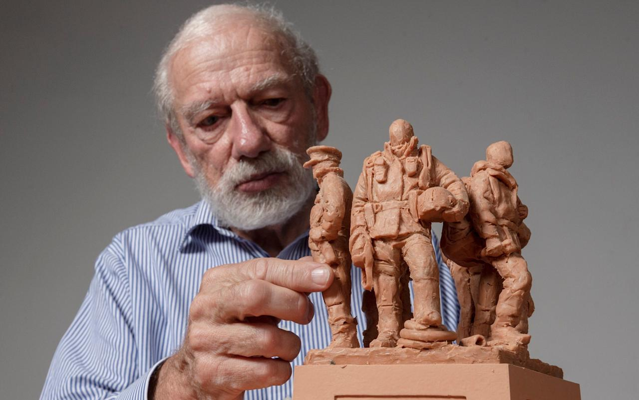 Sculptor Philip Jackson with a maquette of a planned memorial for all emergency services workers - Geoff Pugh