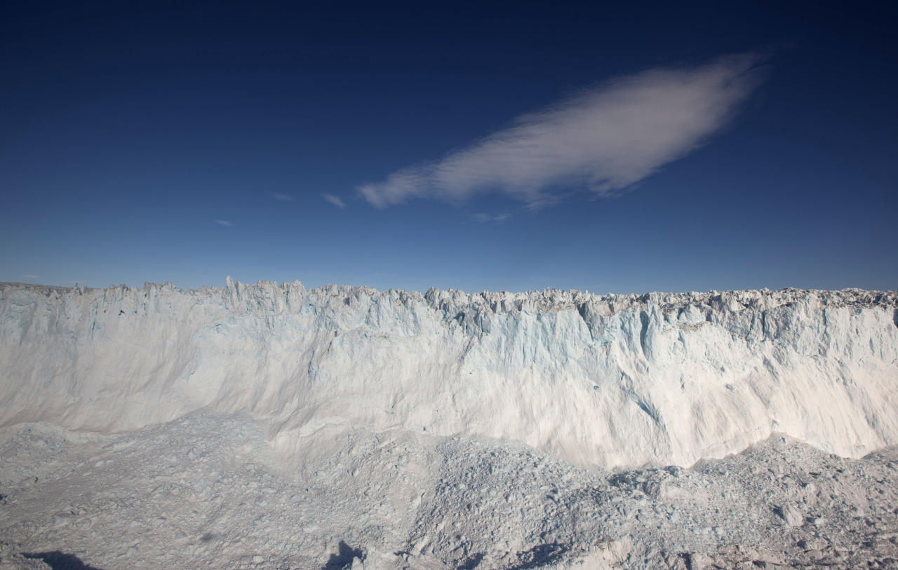 In this July 19, 2011 photo, a cloud drifts past the ever-collapsing calving 6-kilometer-wide (4-mile-wide) front of Jakobshavn Glacier, situated at the edge of the vast Greenland ice sheet, near Ilulissat, Greenland. Greenland is the focus of many researchers trying to determine how much its melting ice may raise sea levels. (AP Photo/Brennan Linsley)