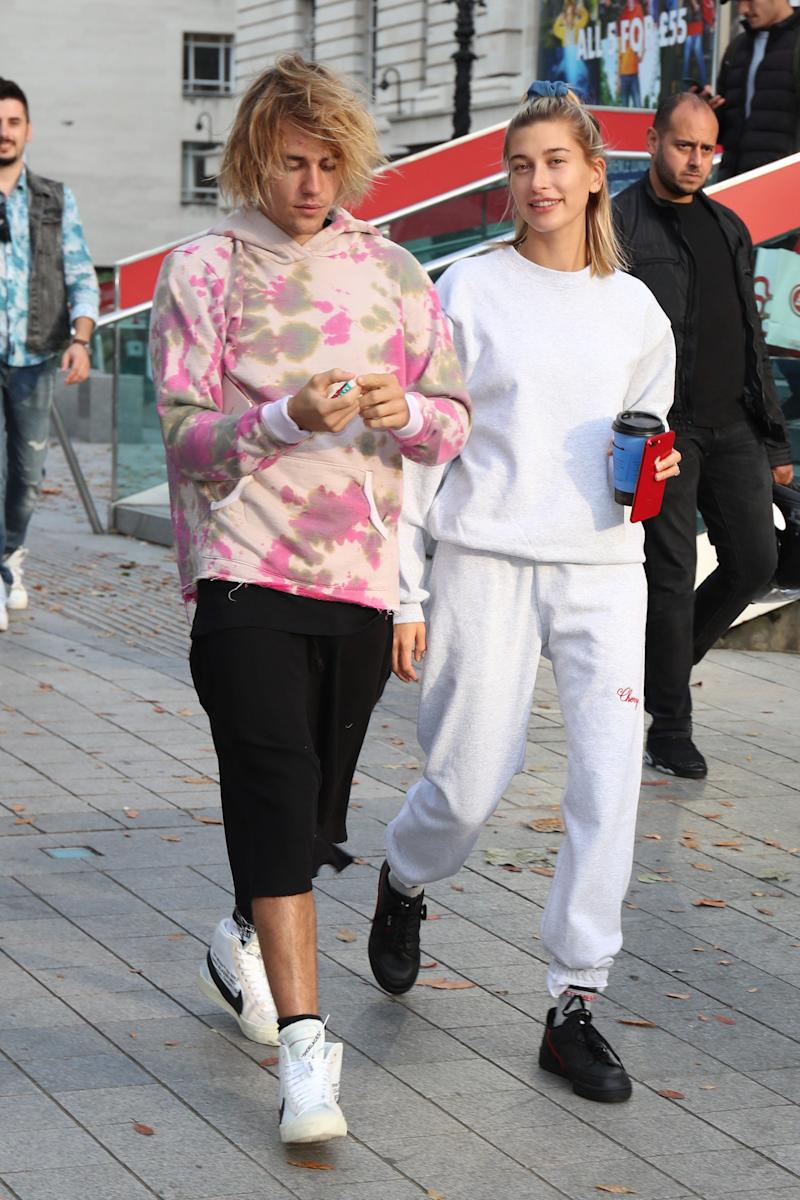 Justin and Hailey Bieber don't always wear coordinated outfits, but when they do, they really go all in. During atrip to London in September 2018, they were both spotted wearing sweats. Naturally, Justin wore tie-dye — keeping his outfit in line with those surfer vibes he'd been giving off — while Hailey went for a monochromatic set.