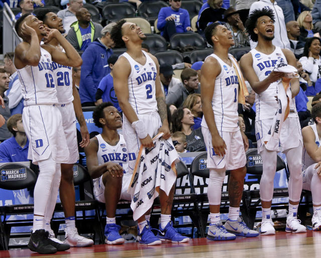 Duke's Javin DeLaurier (12), Marques Bolden (20), Gary Trent Jr. (2), Trevon Duval (1) an Marvin Bagley III, right, cheer as they watch a replay of a dunk by teammate Justin Robinson during the second half of an NCAA men's college basketball tournament first-round game against Iona, Thursday, March 15, 2018, in Pittsburgh. Duke won 89-67 to advance to the second round. (AP)