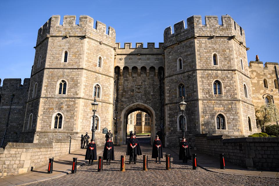 WINDSOR, UNITED KINGDOM - APRIL 13: Stewards are seen outside a gate to Windsor Castle as tributes continue to be made to Prince Philip, Duke Of Edinburgh who died at age 99 on April 13, 2021 in Windsor, United Kingdom. The Queen announced the death of her beloved husband, His Royal Highness Prince Philip, Duke of Edinburgh. HRH passed away peacefully April 9th at Windsor Castle. (Photo by Leon Neal/Getty Images)