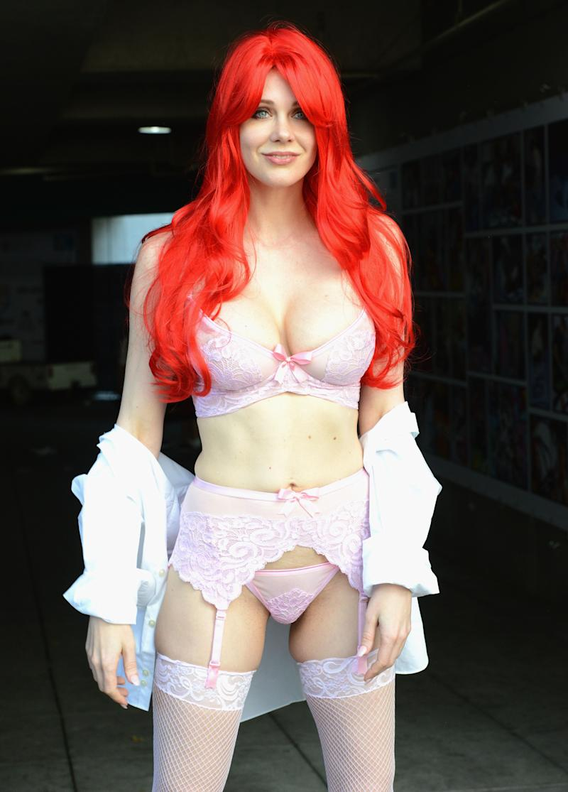 Maitland Ward poses with red hair while wearing lingerie