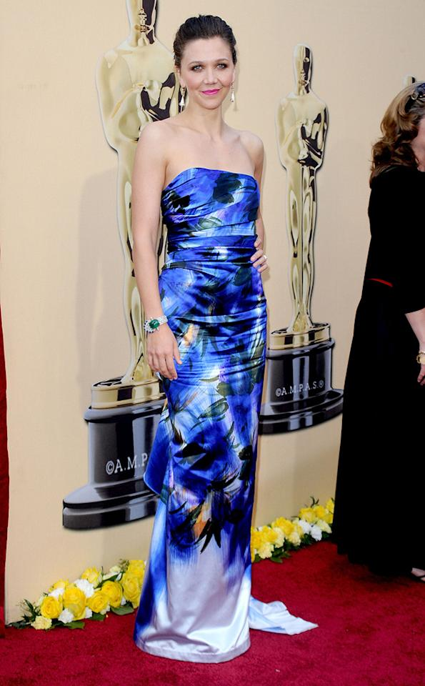 Maggie Gyllenhaal   Grade: B+    The Best Supporting Actress nominee made a bold choice for the evening with this floral Dries Van Noten column gown. Kudos to Maggie for being one of the few who was willing to take a step outside the generic Oscars red carpet box!