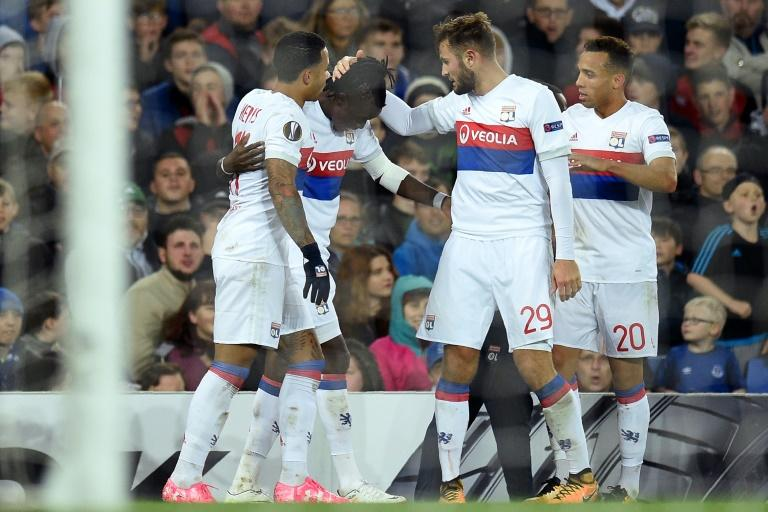 Lyon's Burkinabe striker Bertrand Traore (2nd L) celebrates with teammates after scoring their second goal during the UEFA Europa League Group E match against Everton October 19, 2017