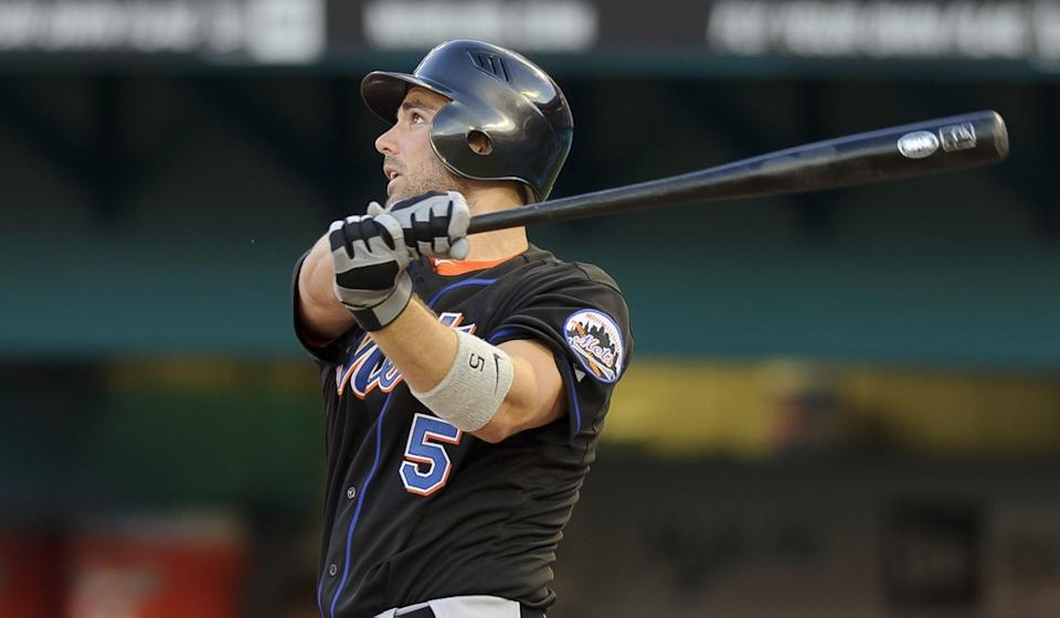 David Wright takes a swing while wearing Mets' black uniform