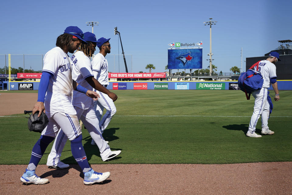 Toronto Blue Jays, from left, Bo Bichette, Vladimir Guerrero Jr., Lourdes Gurriel Jr., and Danny Jansen (9) walk off after an extra inning loss to the Tampa Bay Rays during a baseball game Monday, May 24, 2021, in Dunedin, Fla. The Blue Jays will be fininshing the rest of their home season in Buffalo. (AP Photo/Chris O'Meara)