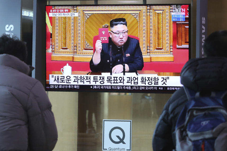 "People watch a TV screen showing North Korean leader Kim Jong Un during a ruling party congress, at the Seoul Railway Station in Seoul, South Korea, Wednesday, Jan. 6, 2021. Kim opened his country's first ruling party congress in five years with an admission of policy failures and a vow to set new developmental goals, state media reported Wednesday. The sign reads ""New goals and tasks to be confirmed."" (AP Photo/Ahn Young-joon)"