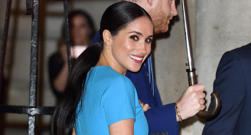 The Duchess of Sussex swapped her trademark nude lip for a bold berry hue at the Endeavour Fund Awards in London. (Photo by Karwai Tang/WireImage)