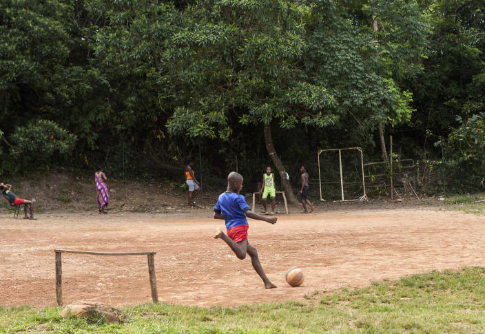 Children play soccer in the slum district of Mont Baduel, in Cayenne, French Guiana, Friday, July 10, 2020. France's most worrisome virus hotspot is in fact on the border with Brazil - in French Guiana, a former colony where health care is scarce and poverty is rampant. The pandemic is exposing deep economic and racial inequality in French Guiana that residents say the mainland has long chosen to ignore. (AP Photo/Pierre Olivier Jay)