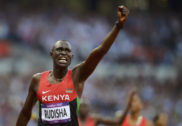 Kenya's David Lekuta Rudisha reacts after he won gold in the men's 800m final during the London 2012 Olympic Games at the Olympic Stadium August 9, 2012. Rudisha also set a new world record time of one minute 40.91 seconds in the 800m final. REUTERS/Dylan Martinez (BRITAIN - Tags: OLYMPICS SPORT ATHLETICS TPX IMAGES OF THE DAY)