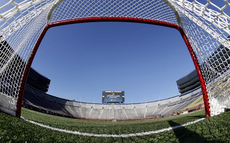 FILE - In this Feb. 9, 2012, file photo, a view from inside a hockey net shows Michigan Stadium in Ann Arbor, Mich.,  after the announcement of the NHL Winter Classic hockey game. The NHL has canceled the 2013 Winter Classic at Michigan Stadium. The signature event between the Detroit Red Wings and Toronto Maple Leafs, is the latest casualty from the labor dispute that has put the season on hold, a person familiar with the situation told The Associated Press on Friday, Nov. 2, 2012. (AP Photo/Paul Sancya, File)