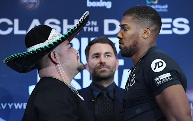 Andy Ruiz Jr faces up to Anthony Joshua at a press conference in London - REX