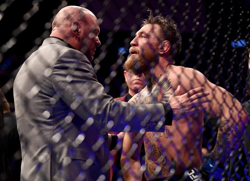 Conor McGregor talks to UFC president Dana White following his loss to Khabib Nurmagomedov at UFC 229 at T-Mobile Arena in Las Vegas. (Getty Images)