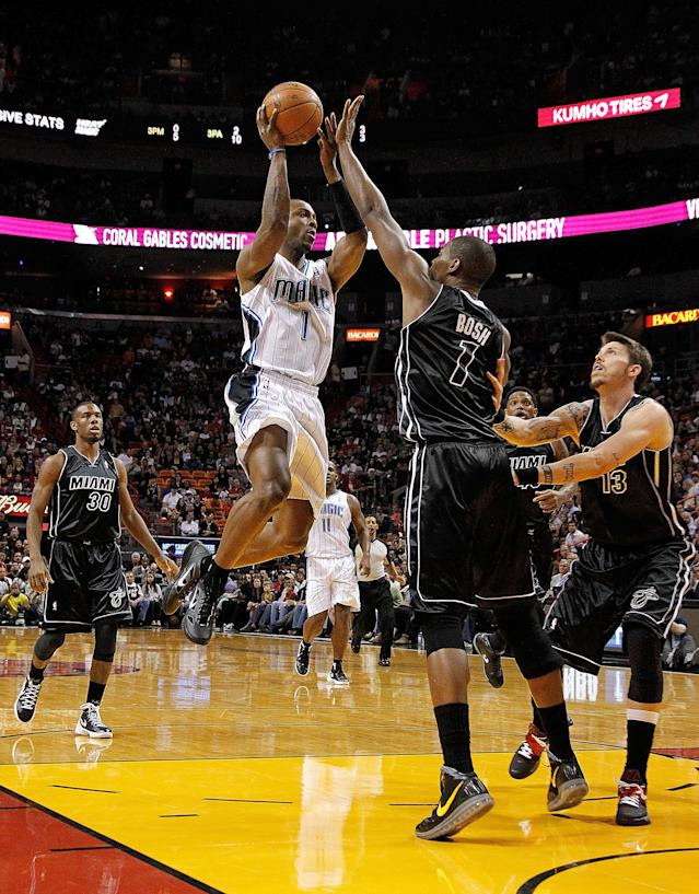 MIAMI, FL - FEBRUARY 19: Von Wafer #1 of the Orlando Magic shoots over Chris Bosh #1 of the Miami Heat during a game at American Airlines Arena on February 19, 2012 in Miami, Florida. NOTE TO USER: User expressly acknowledges and agrees that, by downloading and/or using this Photograph, User is consenting to the terms and conditions of the Getty Images License Agreement. (Photo by Mike Ehrmann/Getty Images)
