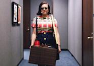 """<p>It's no shame and all game in Peggy's iconic entrance into the McCann offices, one of the coolest scenes in the entire seven seasons of <i>Mad Men</i>. Hungover, sporting shades and a cigarette dangling from her mouth, Peggy strolls into the office with a box of her personal items and Bert Cooper's framed print of <a href=""""https://s-media-cache-ak0.pinimg.com/736x/58/38/49/5838493c11293747c8611b88003405b4.jpg"""" rel=""""nofollow noopener"""" target=""""_blank"""" data-ylk=""""slk:The Dream of the Fisherman's Wife"""" class=""""link rapid-noclick-resp"""">The Dream of the Fisherman's Wife</a> tucked under arm, just daring anyone to think she doesn't deserve to be there. It was no surprise when <a href=""""http://www.nydailynews.com/entertainment/tv/elizabeth-moss-peggy-walk-mccann-no-fun-film-article-1.2247767"""" rel=""""nofollow noopener"""" target=""""_blank"""" data-ylk=""""slk:Elisabeth Moss revealed"""" class=""""link rapid-noclick-resp"""">Elisabeth Moss revealed</a> the crew played """"Stayin' Alive"""" to help her get into the right frame of mind to pull off the swagger: The song would have been the moment's perfect soundtrack, if not for series creator's Matt Weiner's strict rule about avoiding anachronisms. <i>— KP</i></p><p><i>(Credit: AMC)</i></p>"""