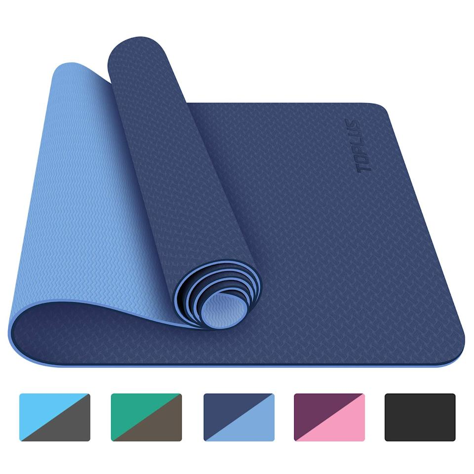 """<h3>Toplus Yoga Mat - Classic 1/4 inch Eco-Friendly Non Slip</h3><br><strong>Best For: Planet-Friendly Yoga</strong><br>This reversible mat isn't just super cute <em>and</em> sturdy. It's made of thermoplastic elastomers (TPE), a recycled foam material that's also biodegradable. It's a win for sustainability <em>and </em>your practice.<br><br><strong>The Hype: </strong>4.4 out of 5 stars and 1,232 reviews on <a href=""""https://amzn.to/2VhT7g1"""" rel=""""nofollow noopener"""" target=""""_blank"""" data-ylk=""""slk:Amazon"""" class=""""link rapid-noclick-resp"""">Amazon</a><br><br><strong>Yogis Say:</strong> """"Holy anti-slip. I thought my previous mat was good but nope it had nothing on this one. This mat has a defined top and bottom. The pink bottom has waves cut into to add traction. They work great, unlike thicker mats I've had before. This one stays in its place on the floor, no entire mat sliding across the floor with this one. The purple top has a texturization that creates a visually attractive pattern while also providing an additional non-slip grip that works phenomenally. Seriously, I used to need traction gloves to work on handstands on my old mat now despite my hands being just as slippery they don't slip."""" – T. Martinez, Amazon Reviewer<br><br><strong>TOPLUS</strong> Yoga Mat - Classic 1/4 inch Eco Friendly Non Slip, $, available at <a href=""""https://amzn.to/3c3F8Bi"""" rel=""""nofollow noopener"""" target=""""_blank"""" data-ylk=""""slk:Amazon"""" class=""""link rapid-noclick-resp"""">Amazon</a>"""