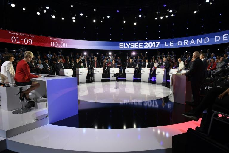 The eleven candidates for the French presidential election attend a debate organised by the private TV channels BFM TV and CNews, on April 4, 2017 in La Plaine-Saint-Denis