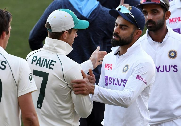 India's captain Virat Kohli congratulates Australia's captain Tim Paine on the third day of the first cricket Test match