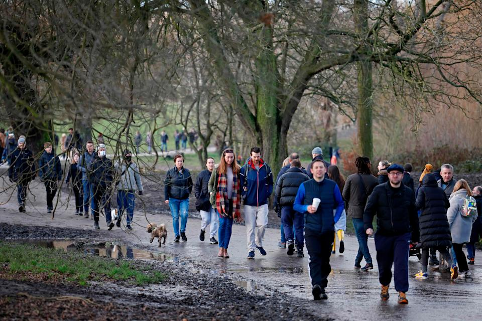 <p>Members of the public enjoy a stroll in Hampstead Heath on London on December 27, 2020</p>AFP via Getty Images