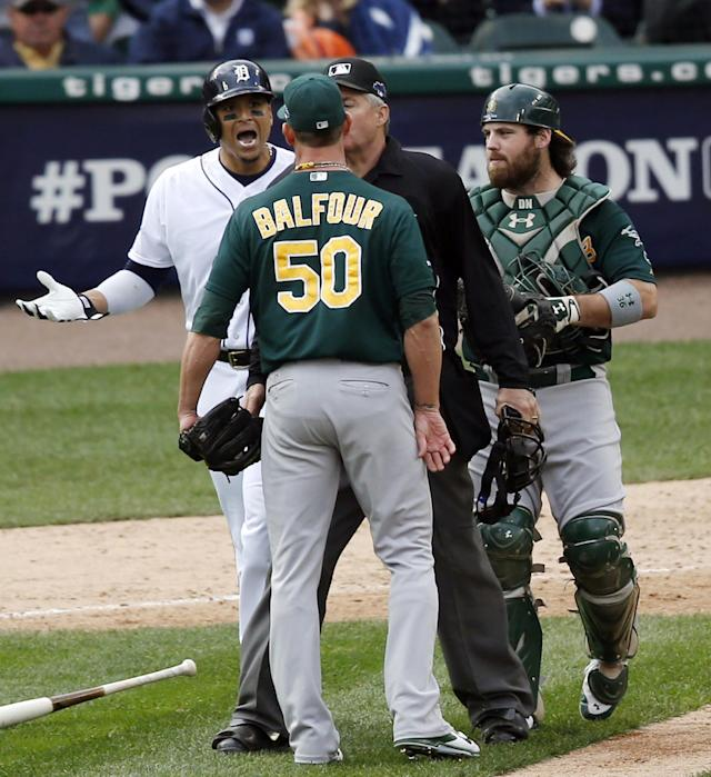 Home plate umpire Gary Darling, second from right, steps between Detroit Tigers designated hitter Victor Martinez, left, and Oakland Athletics relief pitcher Grant Balfour (50) during the ninth inning of Game 3 of an American League baseball division series in Detroit, Monday, Oct. 7, 2013. (AP Photo/Charles Rex Arbogast)