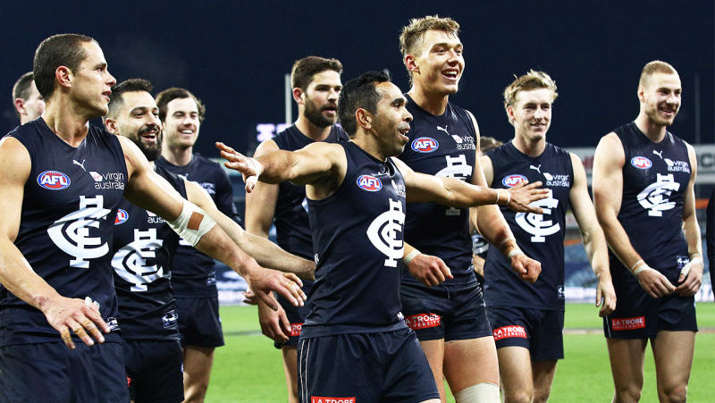 Eddie Betts and Carlton teammates celebrating after a win.