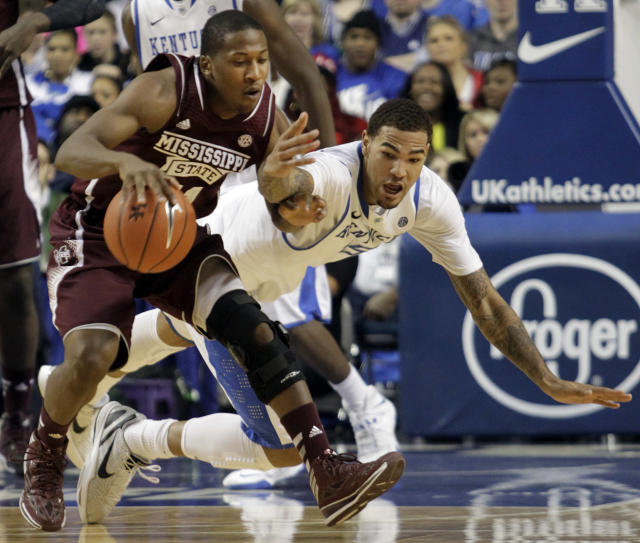 Mississippi State's Jacoby Davis, left, is pressured by Kentucky's Willie Cauley-Stein (15) during the second half of an NCAA college basketball game, Wednesday, Jan. 8, 2014, in Lexington, Ky. Kentucky won 85-63. (AP Photo/James Crisp)