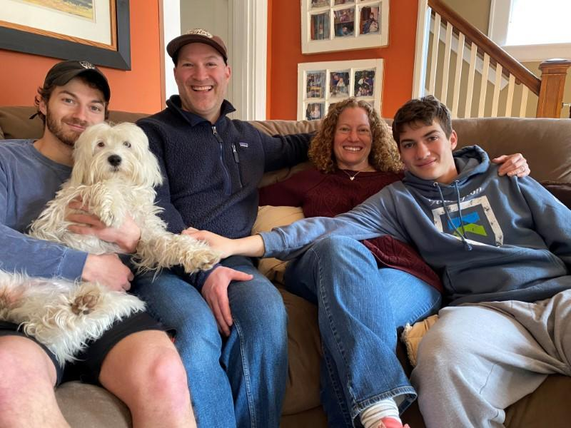 Mark Berkley and Susan Halper Berkley pose for a photo with their sons and dog in Maplewood, New Jersey