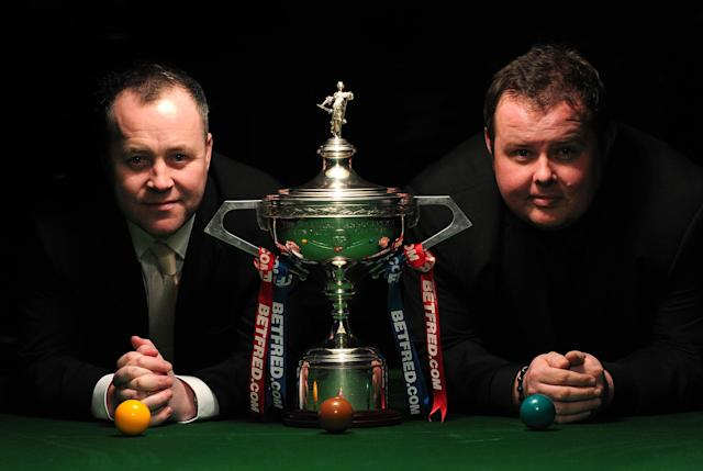 Scottish world snooker champion John Higgins (L) and English contender Stephen Lee (R) pose for photographs flanking the winner's trophy in central London on April 11, 2012, after a press conference to mark the launch of the Snooker World Championships which run from April 21 to May 7 at the Crucible Theatre in Sheffield. AFP PHOTO / CARL COURT (Photo credit should read CARL COURT/AFP/Getty Images)