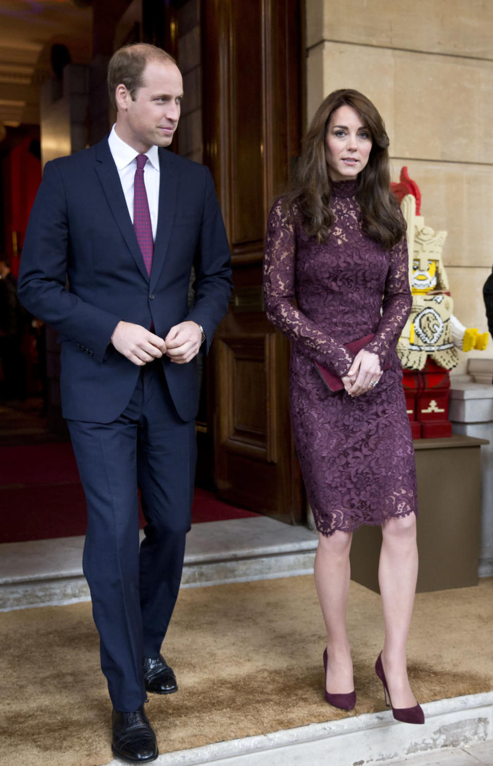 <p>Kate met the President of China in London in a lacy plum dress designed by Dolce & Gabbana. She teamed the look with matching Gianvito Rossi heels and a red Mulberry clutch.</p><p><i>[Photo: PA]</i></p>